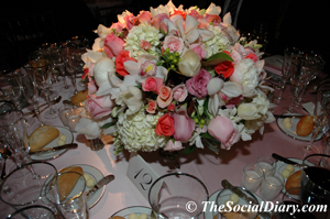 candlelight ball centerpiece of various shades of pink roses