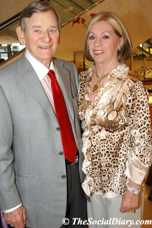 ed and joyce glazer, joyce is wearing an animal print blouse by Roberto Cavalli