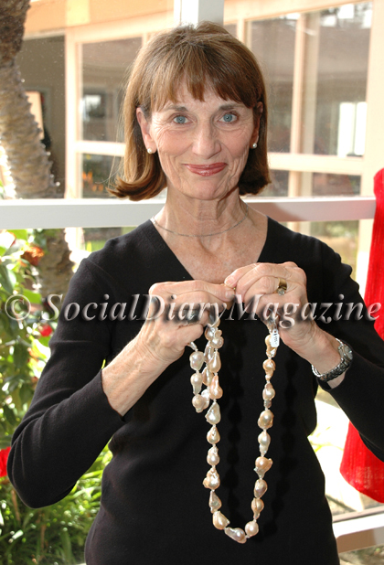 Lori DeMaria trying on necklaces by Reena Horowitz